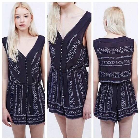 Ecote Magdalena Playsuit in Navy Urban Outfitters boho navy romper from Ecote. Super flattering sleeveless fit with front buttons. Trimmed with swingy shorts. Urban Outfitters Dresses