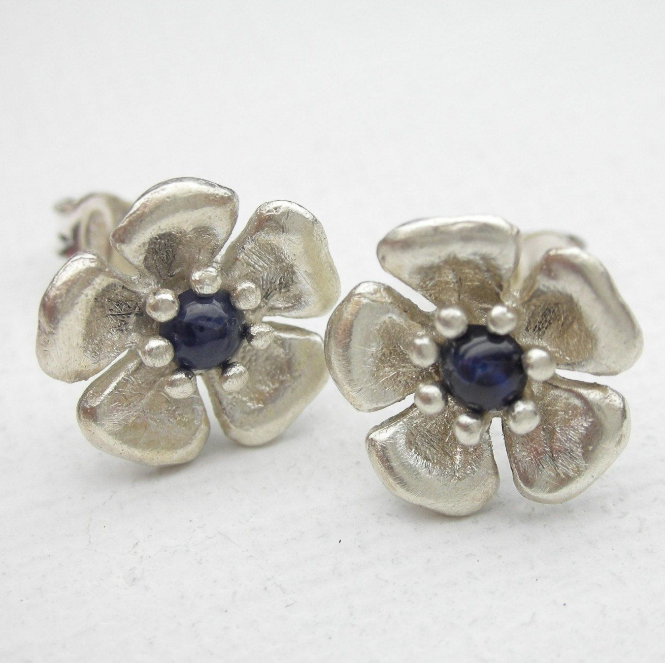 Blue Sapphire cherry blossom earrings in Sterling Silver. $125.00, via Etsy.