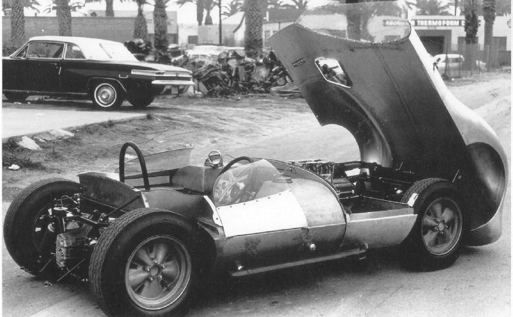 An unpainted Chaparral 1, showing the rear bodywork removed, and the front clip open. Dave Friedman photo.