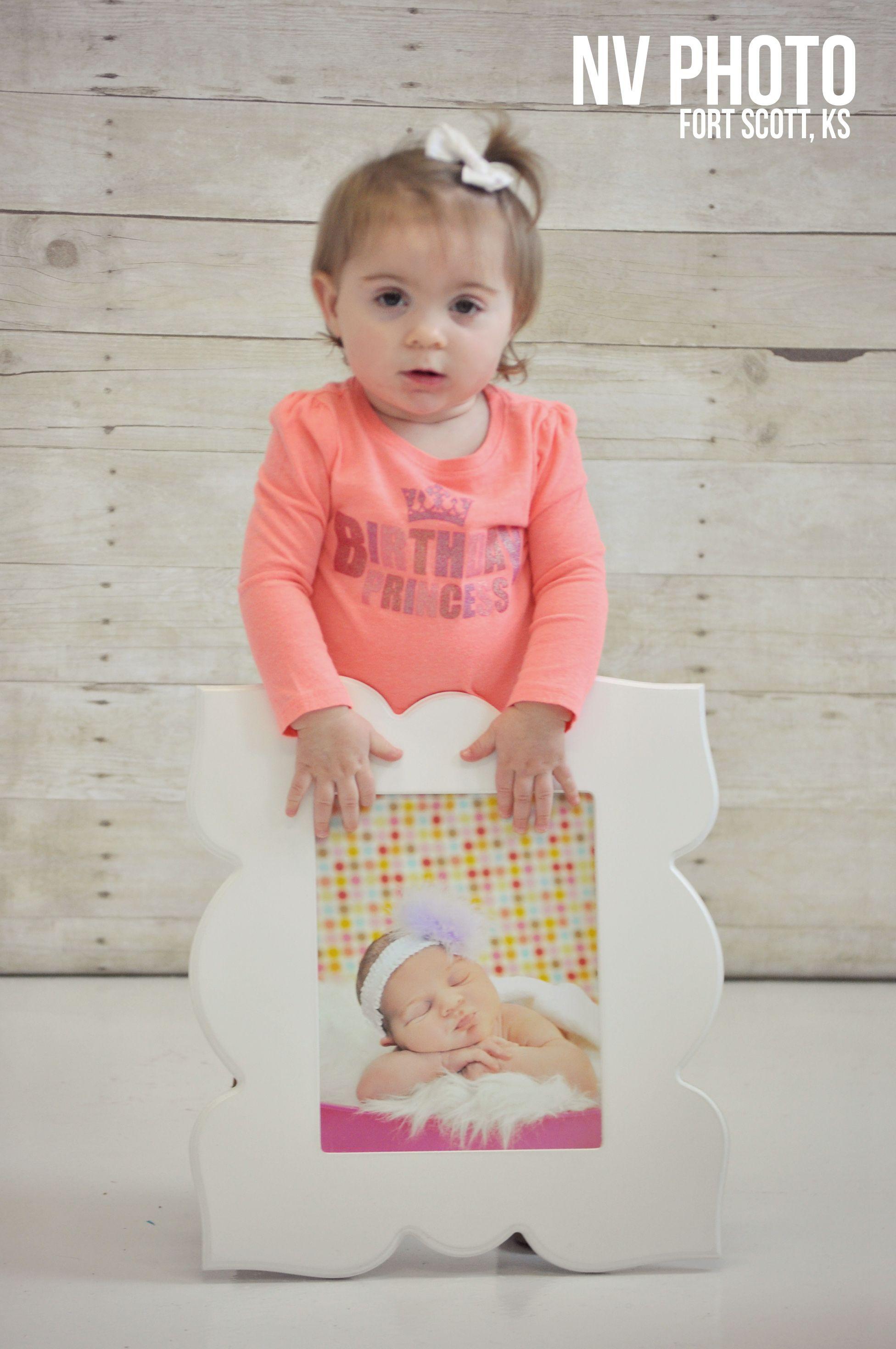 1st birthday photography holding newborn photo print