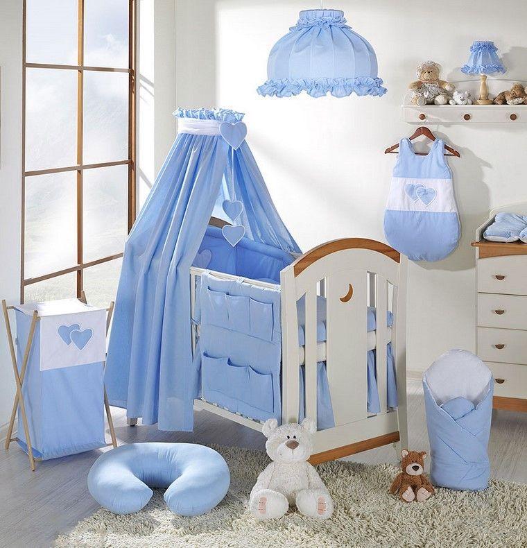 decoraciones en azul y cama blanca - Cunitas De Bebe