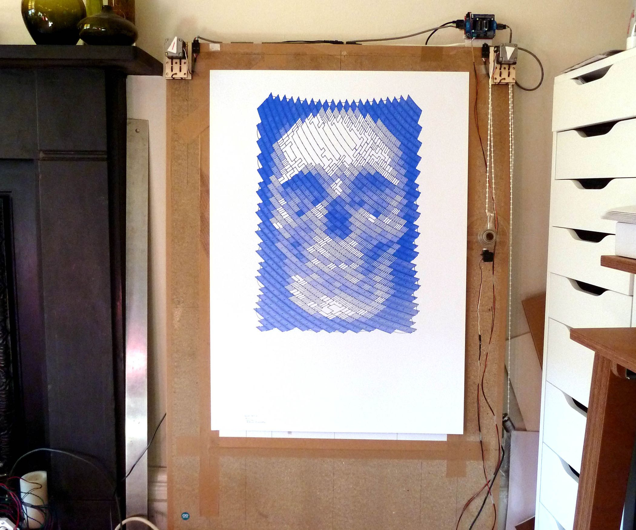 This machine, a variation on the hanging-pen plotter is a conspicuous and wilfully naive attempt to break out of the pristine, pixel perfect, colour-c...