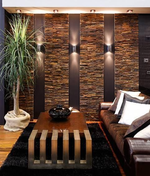 Photo of Parete attrezzata con rivestimento in quarzite marrone. #paredes de piedra comed…