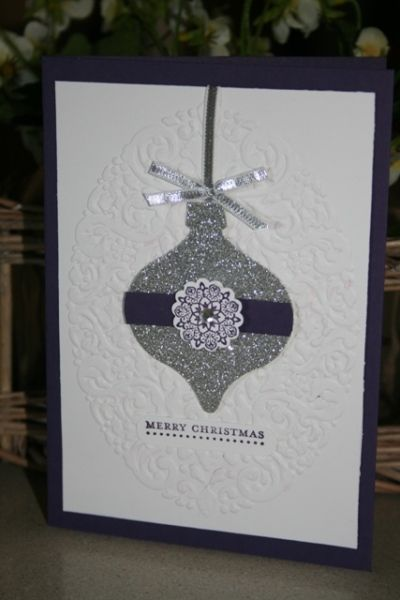 christmas stampa stack 2013 020 -  Vicki Hodgman,   Favourite idea from Carolyn Lindenmayer. Ornament framelit. Holiday Frame Emboss Folder Silver glimmer card, Whisper white, Elegant Eggplant. Silver ribbon.