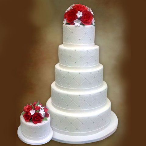 This is the perfect wedding cake. Tall, white, simple, elegant and delicious. Sweet Art by Lucila Cakes.