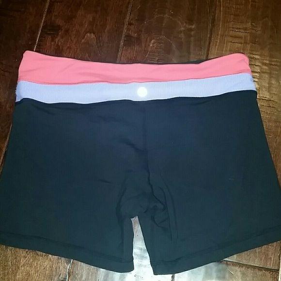 Lululemon Reversible shorts 2 in 1. Reversible shorts. Black shorts or black with orange and purple waistband. lululemon athletica Shorts