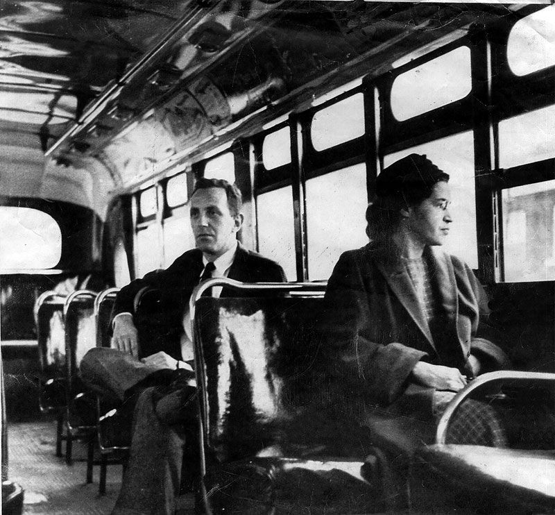 Rosa Parks sits on a Montgomery bus on December 21, 1956, the day Montgomery's public transportation system was legally integrated.