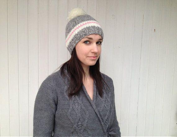 Large pom pom beanie hat.