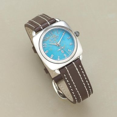 The gemstone face of this classic watch makes it a jewel, complemented by a contrast-stitched brown cowhide band with a sterling silver buckle. Color and matrix of stone will vary. Quartz movement