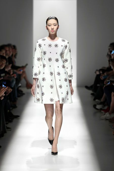 Chic white coat with embroidered detailing by Pierre Balmain #nyfw #classicfashion