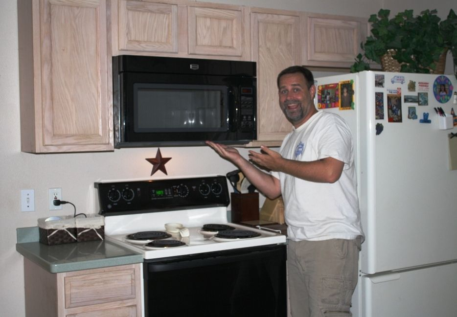 Jason showing off the new Maytag 1.6 cubic ft. over the range microwave he installed yesterday! Next come the new countertops!