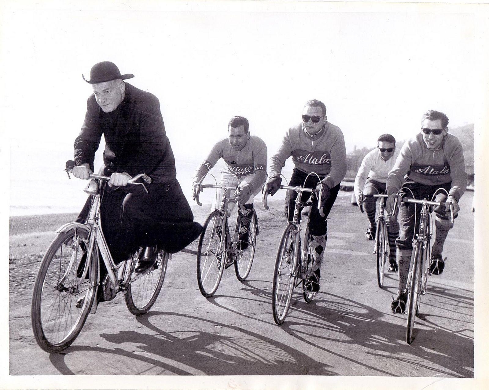 Local priest on same route as Training run for 1959 Giro d Italia. Monti 2c9413bd4