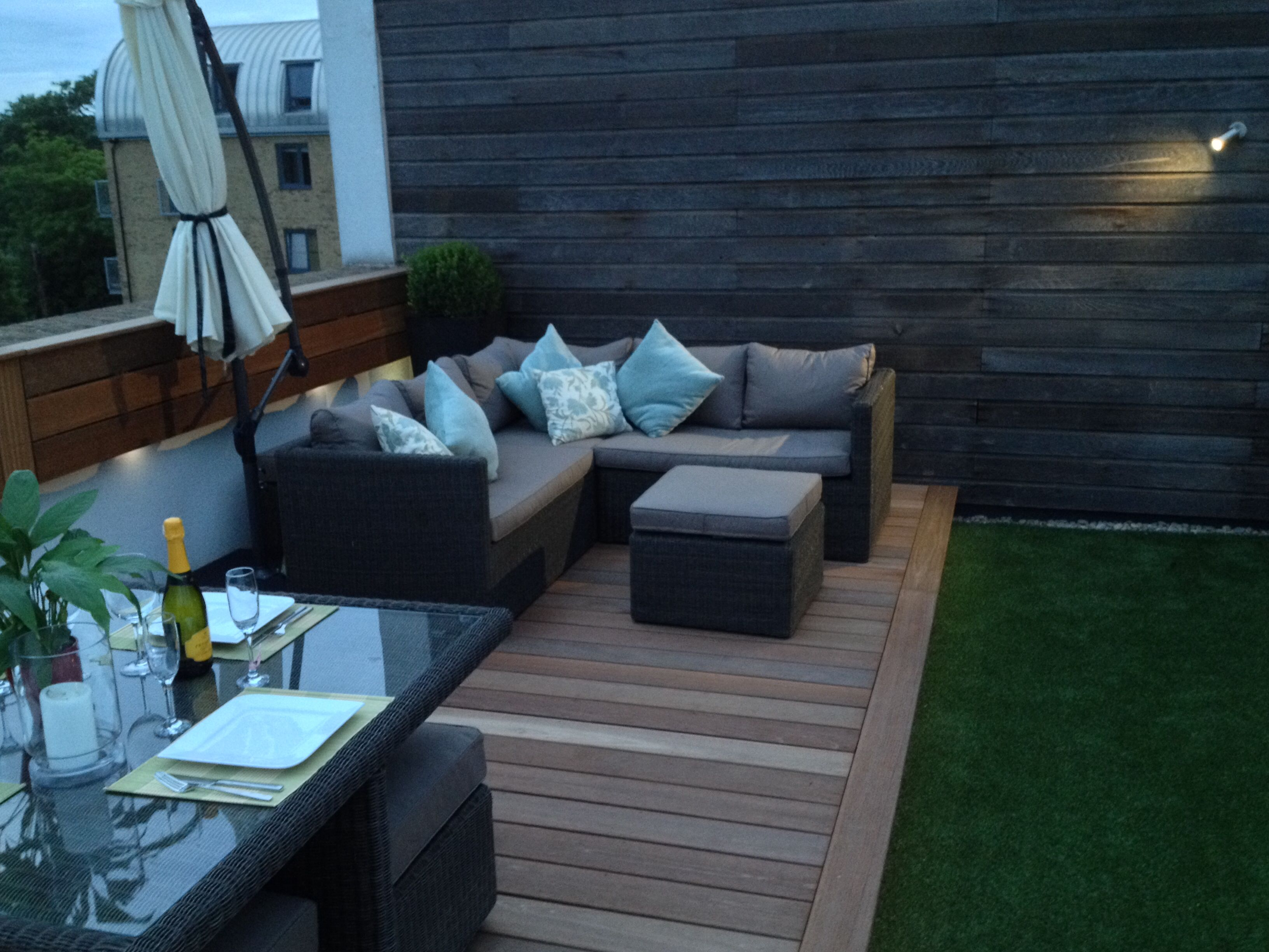Roof terrace furniture on hardwood deck with artificial grass