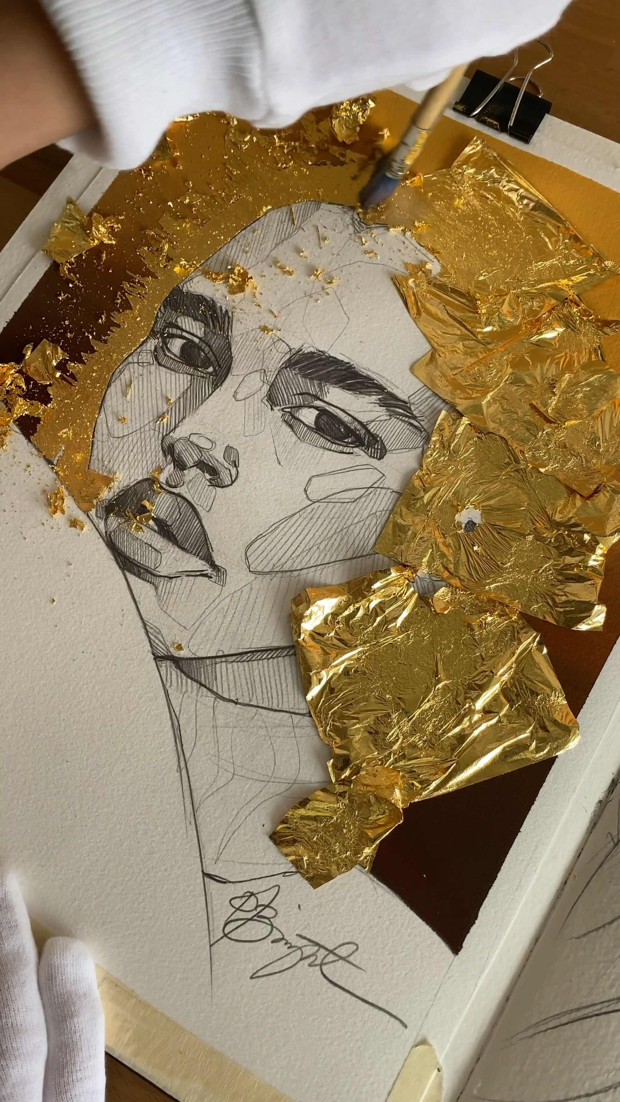 Photo of Applying gold leaf
