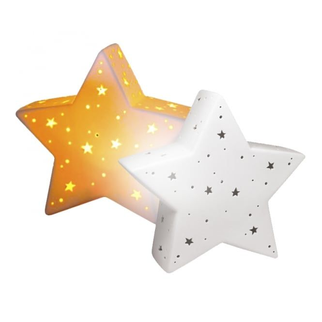 A Decorative Star Shaped Ceramic Table Lamp With Cut Out Star And