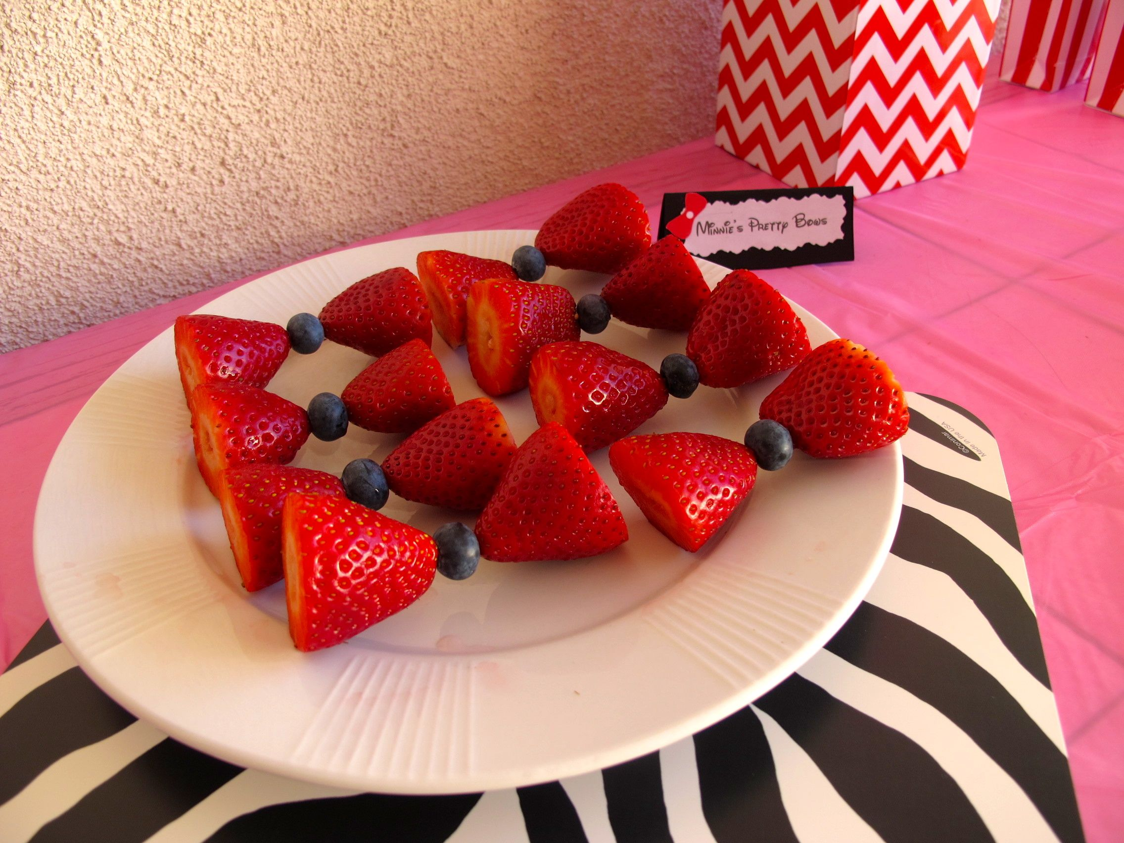 """Strawberries, blueberries and some toothpicks put these adorable """"bows"""". They were easy to put together and super cute!"""