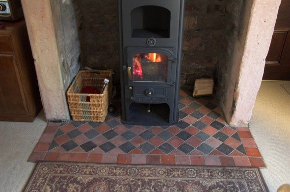 Quarry tile hearth black and red chequered prefer it for Floor hearth