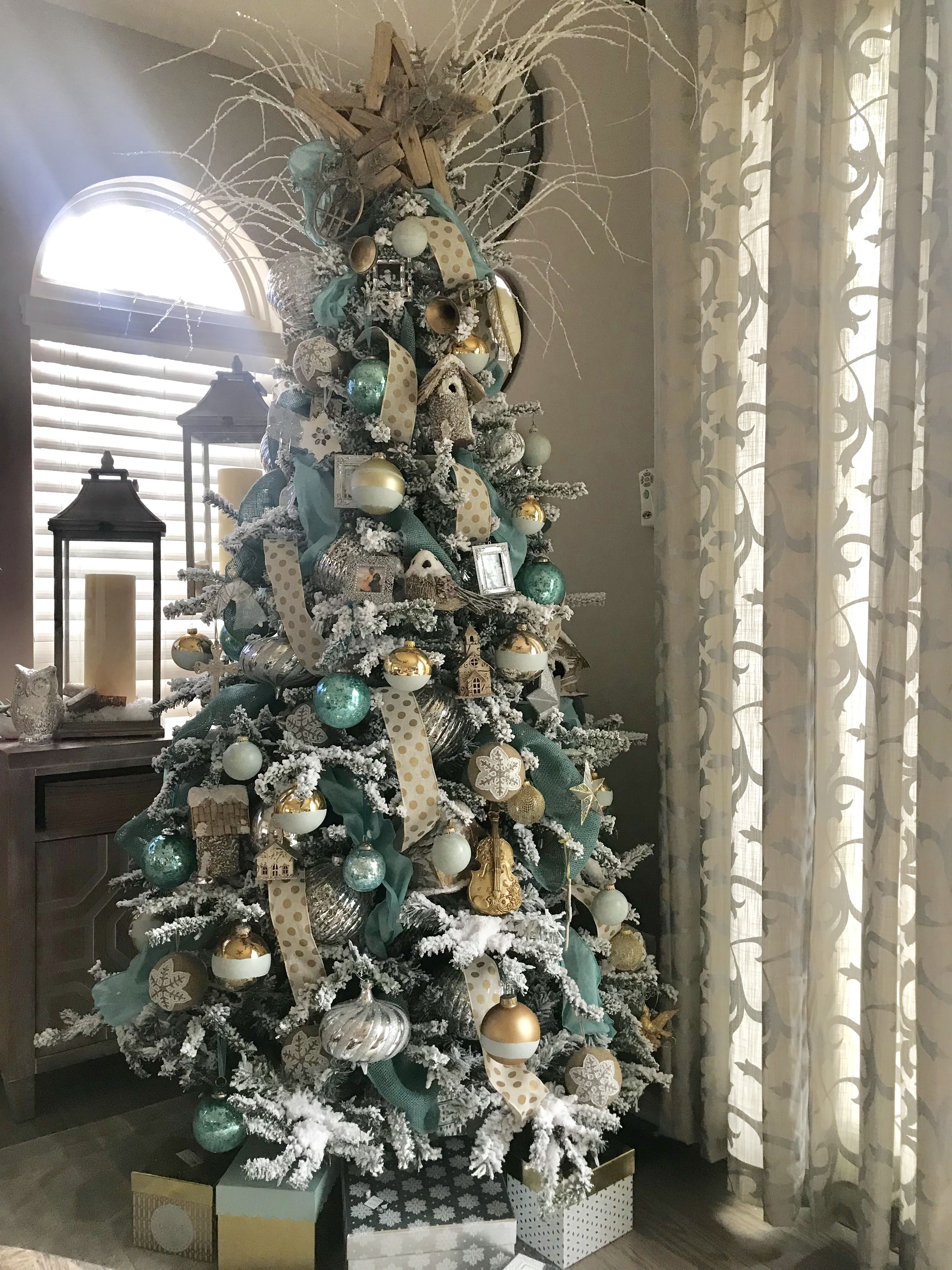 Flocked Christmas Tree Aqua Gold And Silver Aqua Christmas Christmas Tree Decorations Cool Christmas Trees
