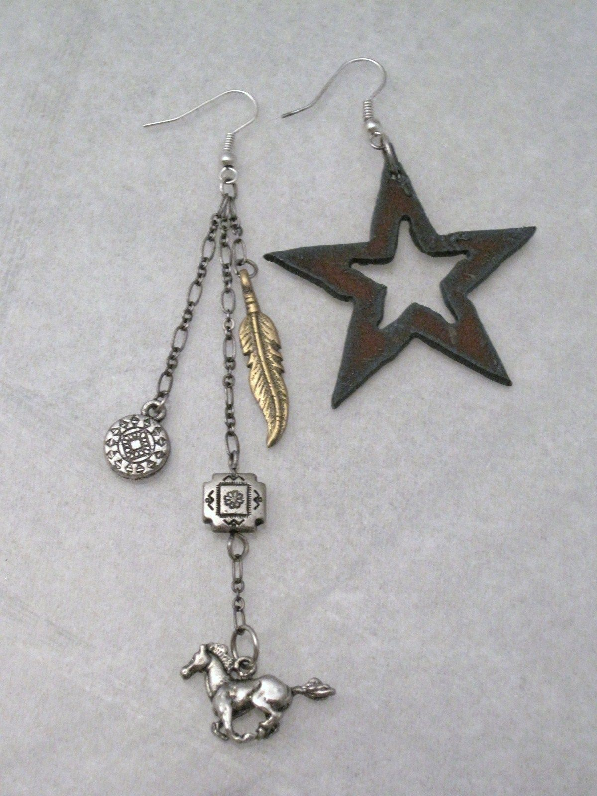 updated picture  western style asymmetrical earrings designed by alexis corelis