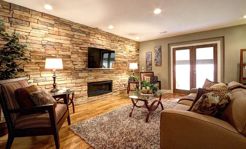Living Room With Stacked Stone Accent Wall Light Green Paint And Wood Floors Accent Walls In Living Room Brick Wall Design Stone Accent Walls