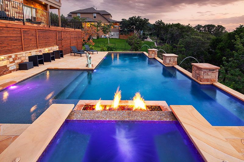 Geometric pool with fire feature columns with jets for Pool jets design
