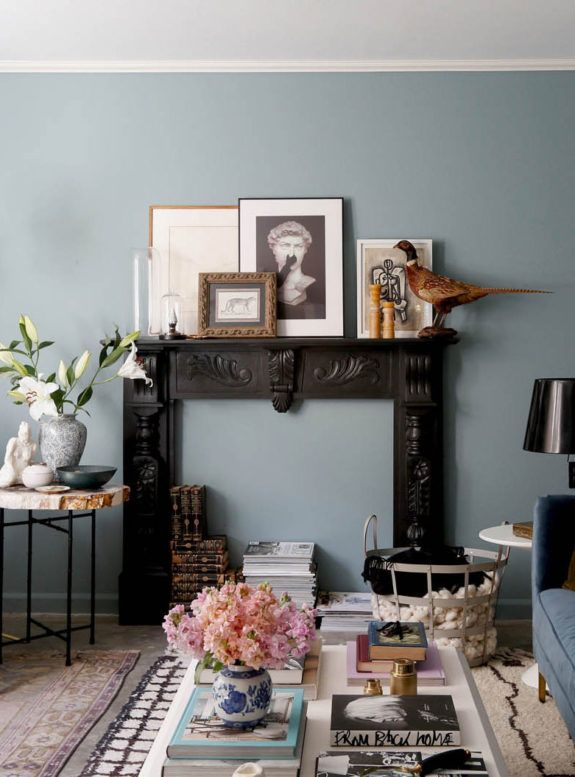 Light Blue Wall With Black Mantle And Assorted Art Sfgirlbybay Blue Walls Living Room Light Blue Living Room Blue Living Room