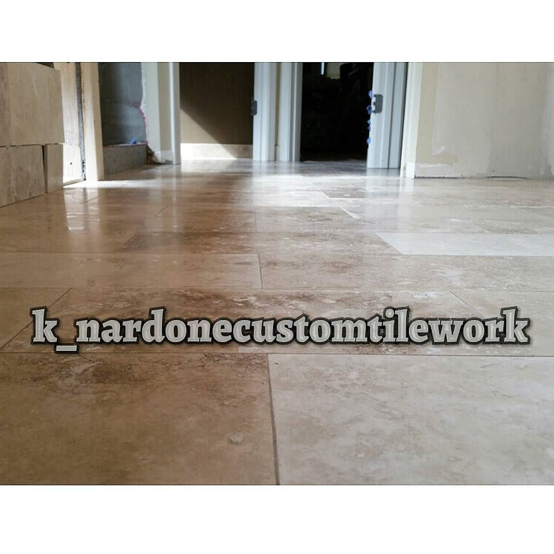 "Just grouted pic of a 8"" x 16"" Travertine master bath floor #allhands #levelgamestrong #tilerspride #tile #tiler #tiling #tilework #tilesetter #travertinetile #tilepicsfordays #mastertilesetter #tileporn #masterbath #tileaddiction  #precisiontilework #interiordesign #interior #tiledesign  #customtile #homeimprovement #remodeling #lionsclub (1/2) by k_nardonecustomtilework"
