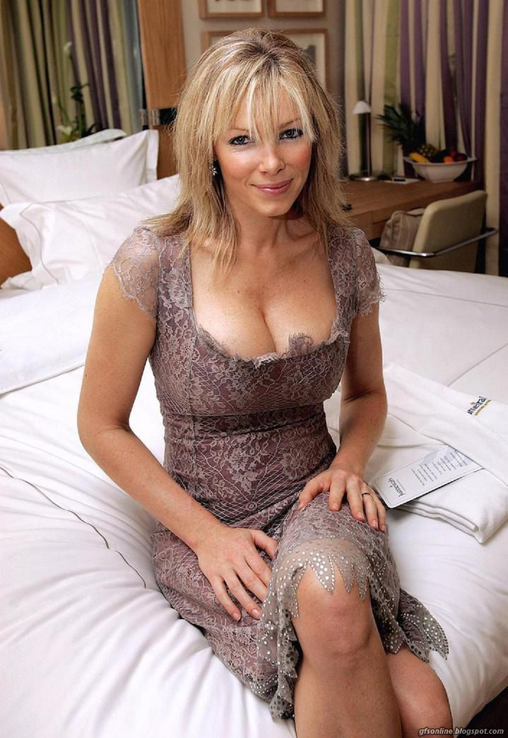 Mature milf lotioning her body