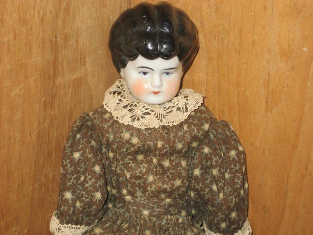 Early China Doll with Brown Calico Dress.......