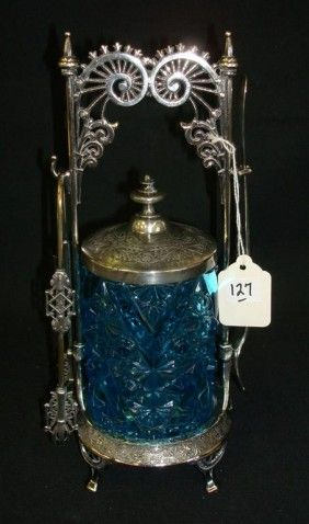 Lot: 127: VICTORIAN PICKLE CASTOR WITH BLUE GLASS INSERT, Lot Number: 0127, Starting Bid: $50, Auctioneer: Mid-Hudson Auction Galleries, Auction: JACK DEGAETANO FINE ART & ANTIQUE AUCTIONS, Date: July 16th, 2011 EDT