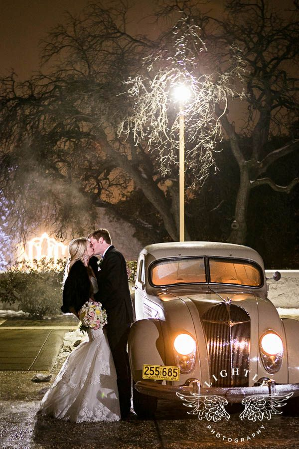 Winter Wedding. Farewell. Classic vintage white limo provided by Silver West. Fur. Classy gown from Bliss Bridal. Elegant. Bouquet designed by Sage Fine Flowers. Fort Worth Wedding. Wedding reception at Stonegate Mansion of Fort Worth. Photo by Amanda with Lightly Photography.
