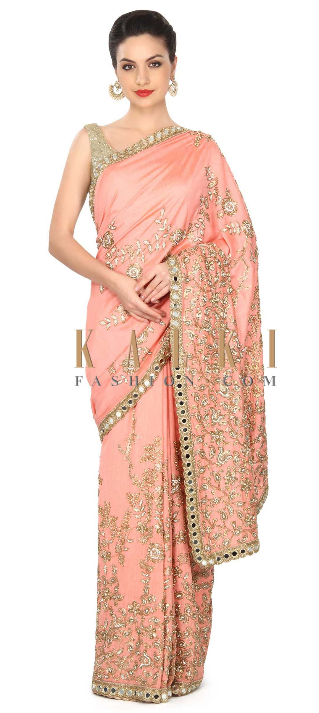 f7c8eb789d Buy this Peach saree adorn in floral and paisley motif embroidery only on  Kal