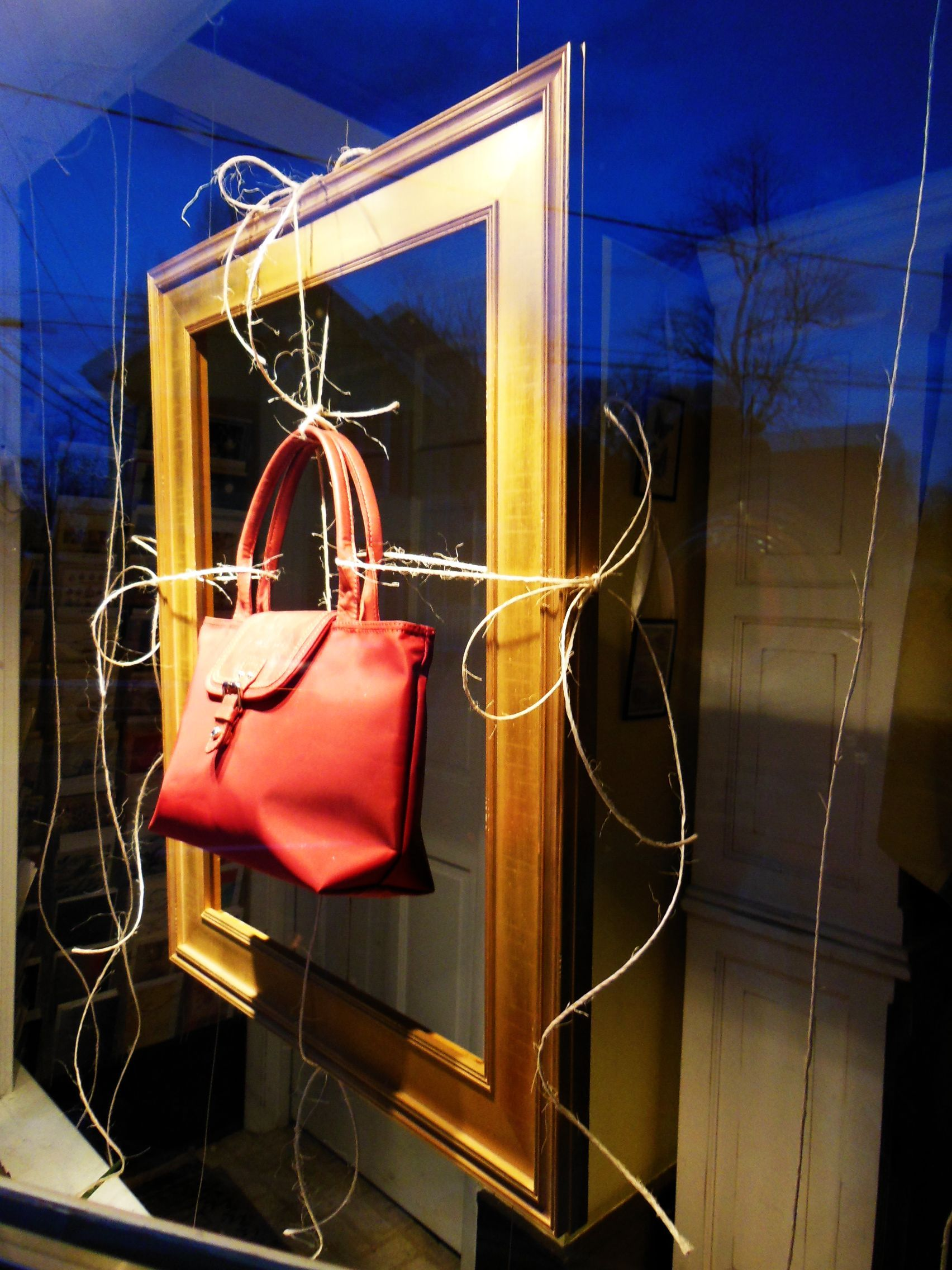 Window Display - French purse tied with twine onto gold ...