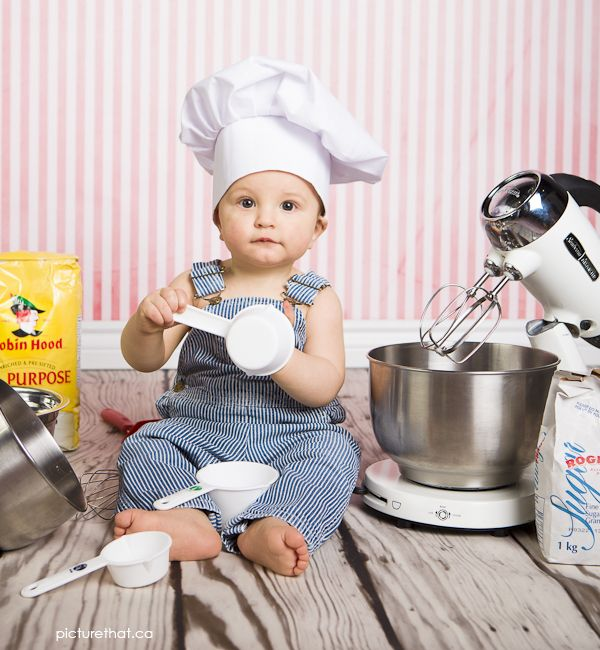 Baby photo in a baker's hat holding baking supplies ...