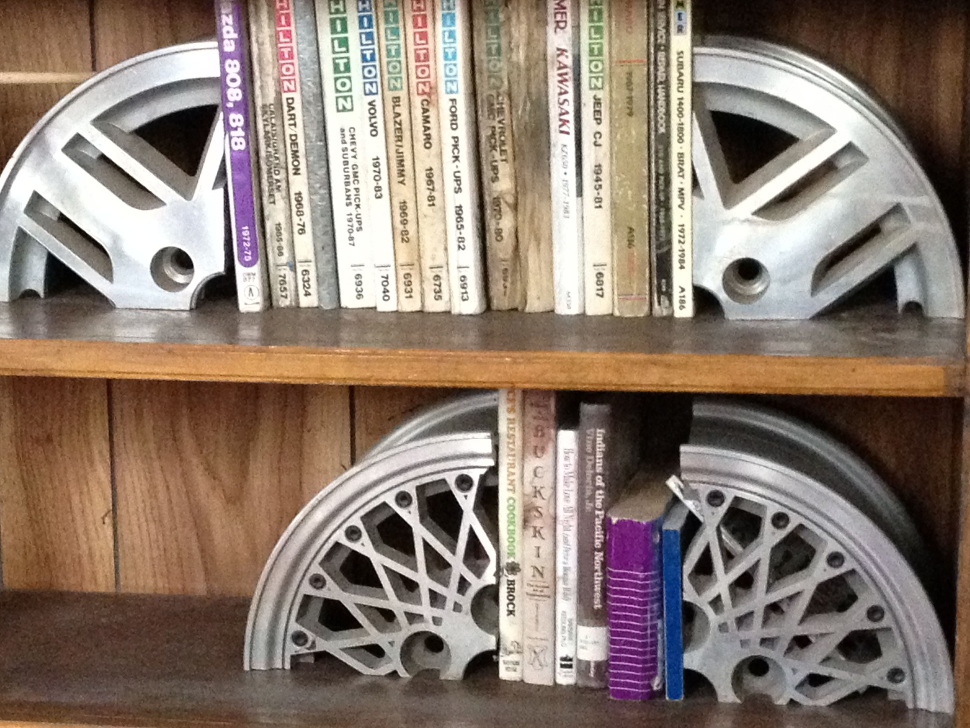Saw this at auto shop, great idea for guys! Car Rim Bookends - Automotive Decor #upcycled #recycled