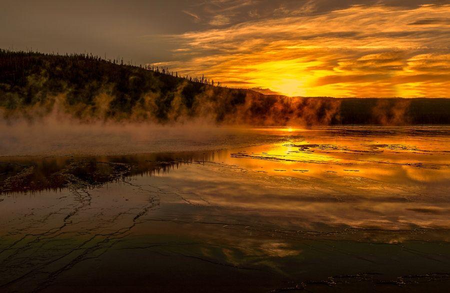 ***Geyser at Sunset (Yellowstone, Wyoming) by Angela Chong / 500px