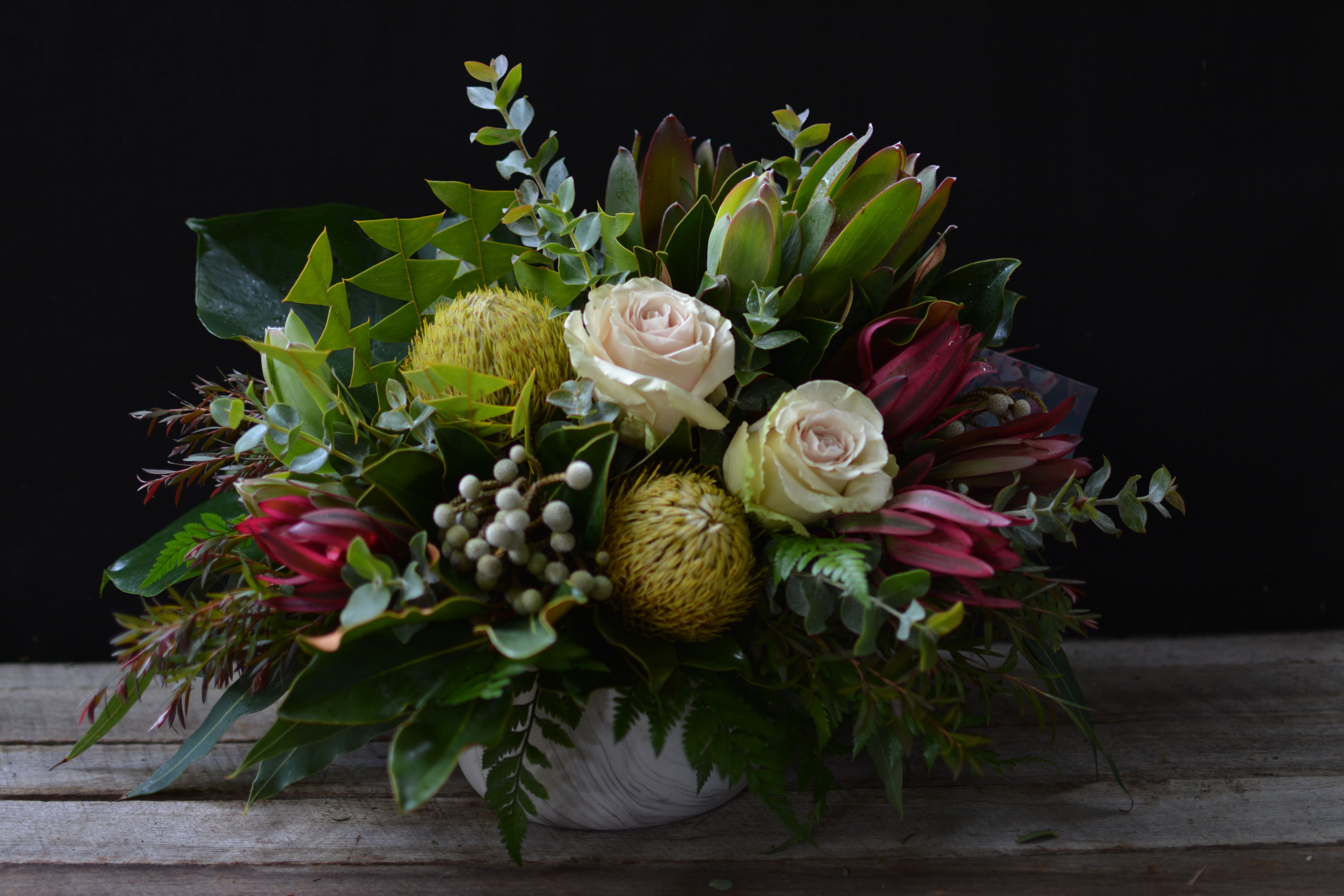 Marbled Pot With Banksia Baxteri Leucadendrons Brunii And Pompeii Roses Nativeflowers Nativ Flower Delivery Australian Native Flowers Flower Arrangements