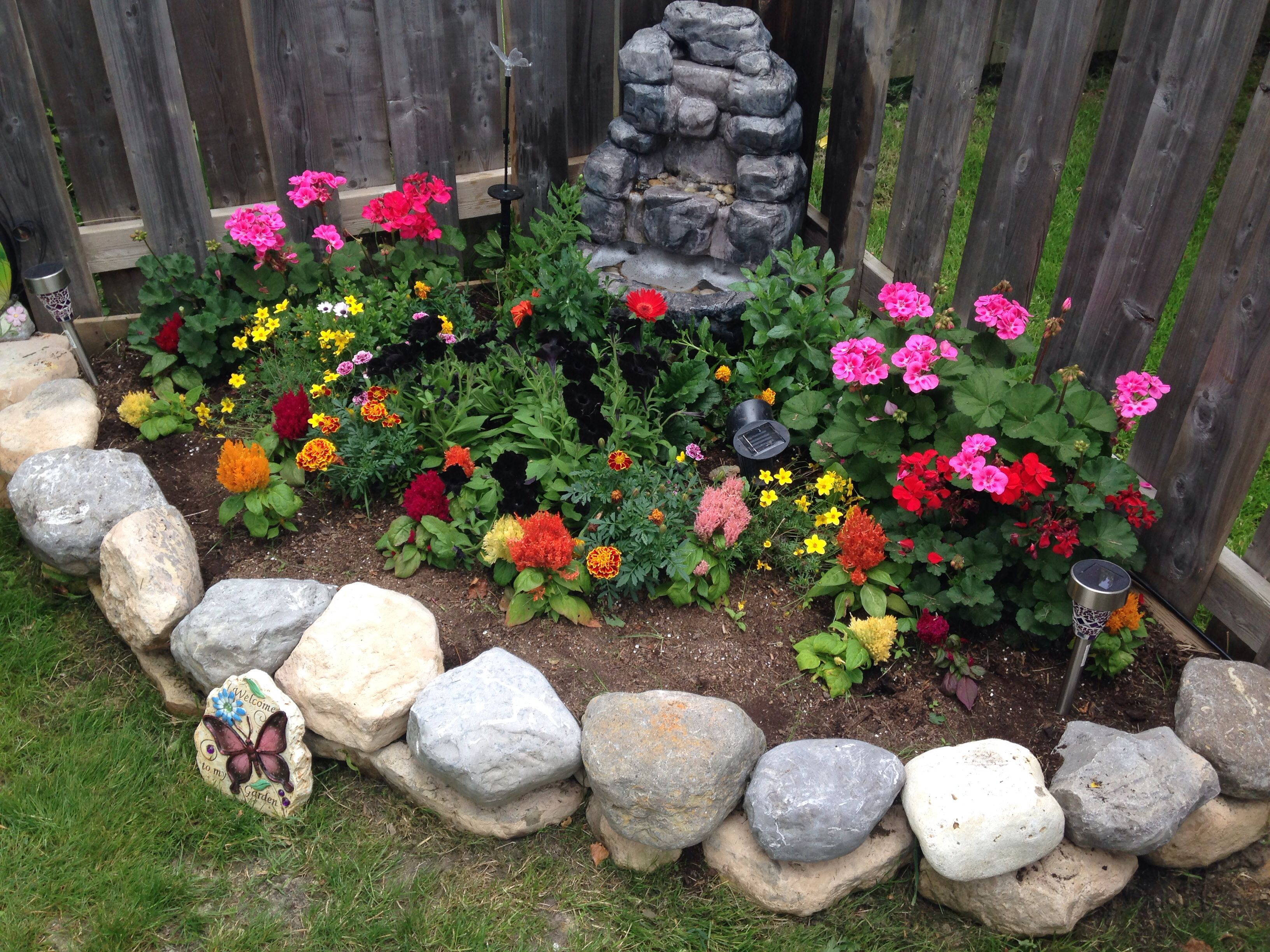 Easy corner flower bed with stone retaining wall corner