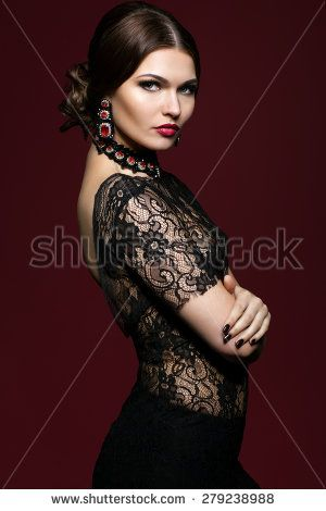 Young beautiful woman in black dress on dark red marsala color background