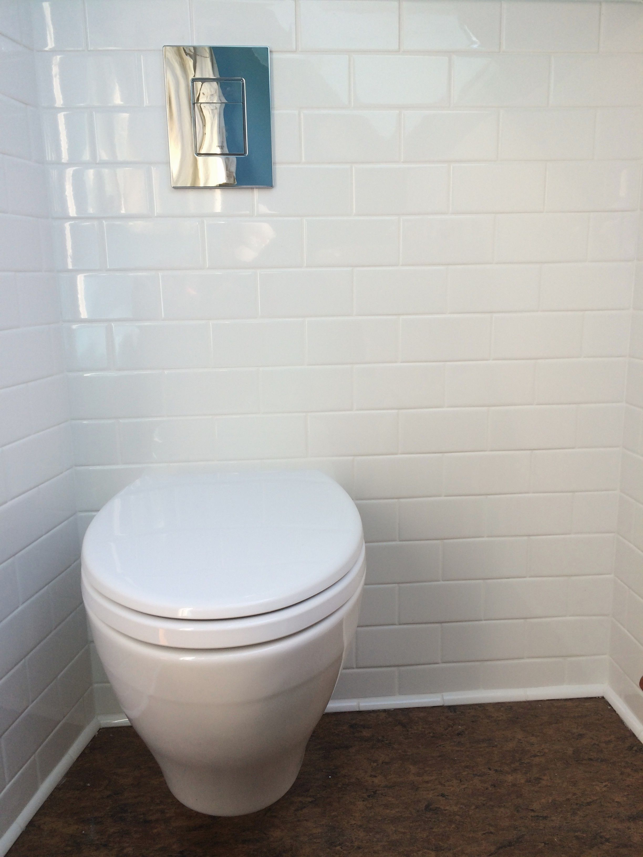 Wall mounted toto toilet with a grohe concealed water tank for Water wall plumbing