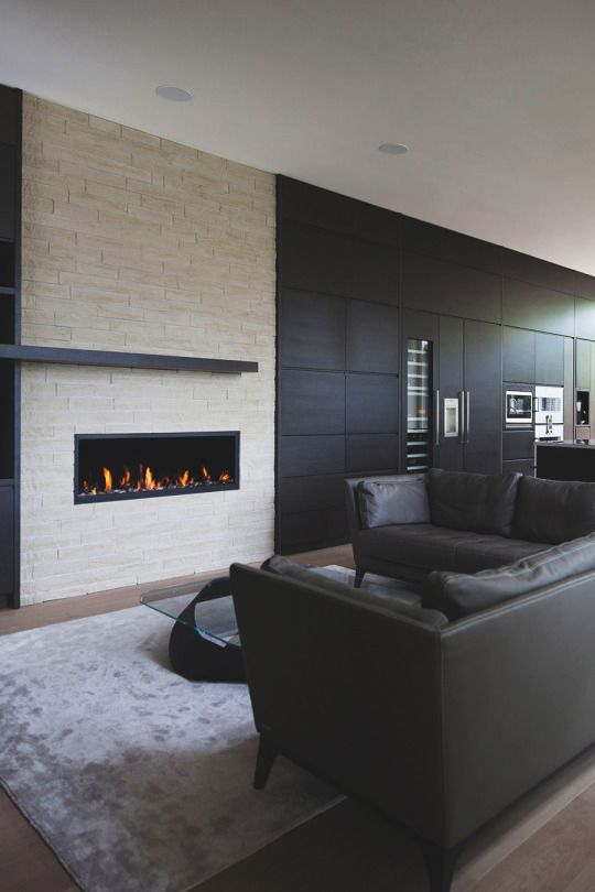 Great living room with gorgeous wall mounted fireplace ...