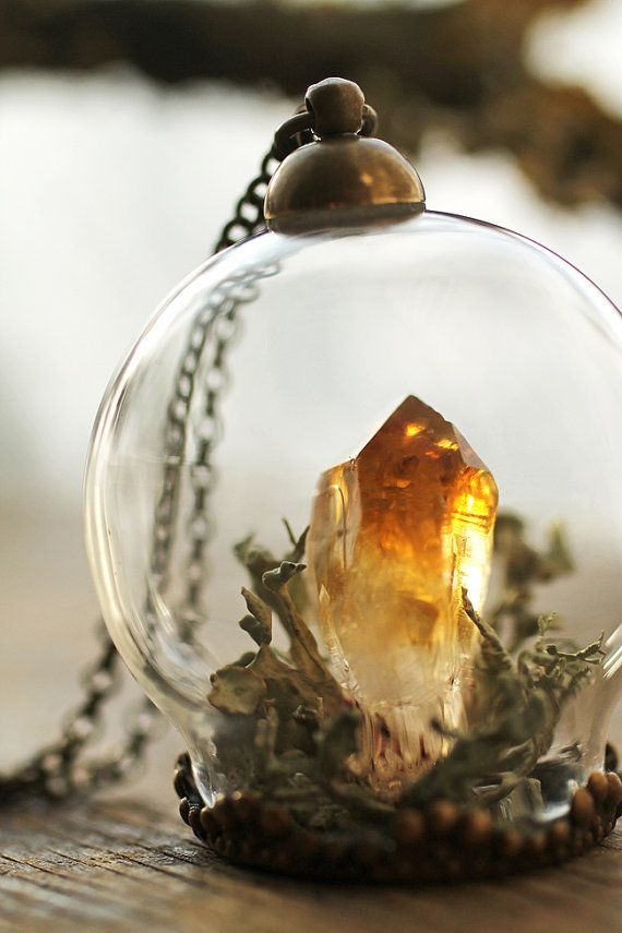 Miniature terrarium pendant made with a beautiful yellow Citrine crystal surrounded by a nest of real Irish lichen and moss. You might also