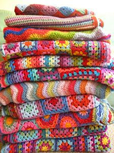 lovely stack of granny square blankets from www.fatblackcatjournal.wordpress.com