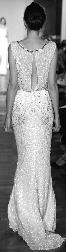 Open back loose vintage wedding dress with a simple updo is ...