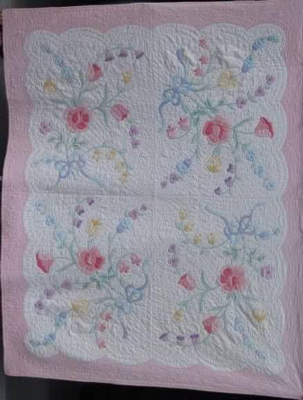 Blue Bow Applique Quilt at www.antiquequilts.com/catalog14.htm#17597