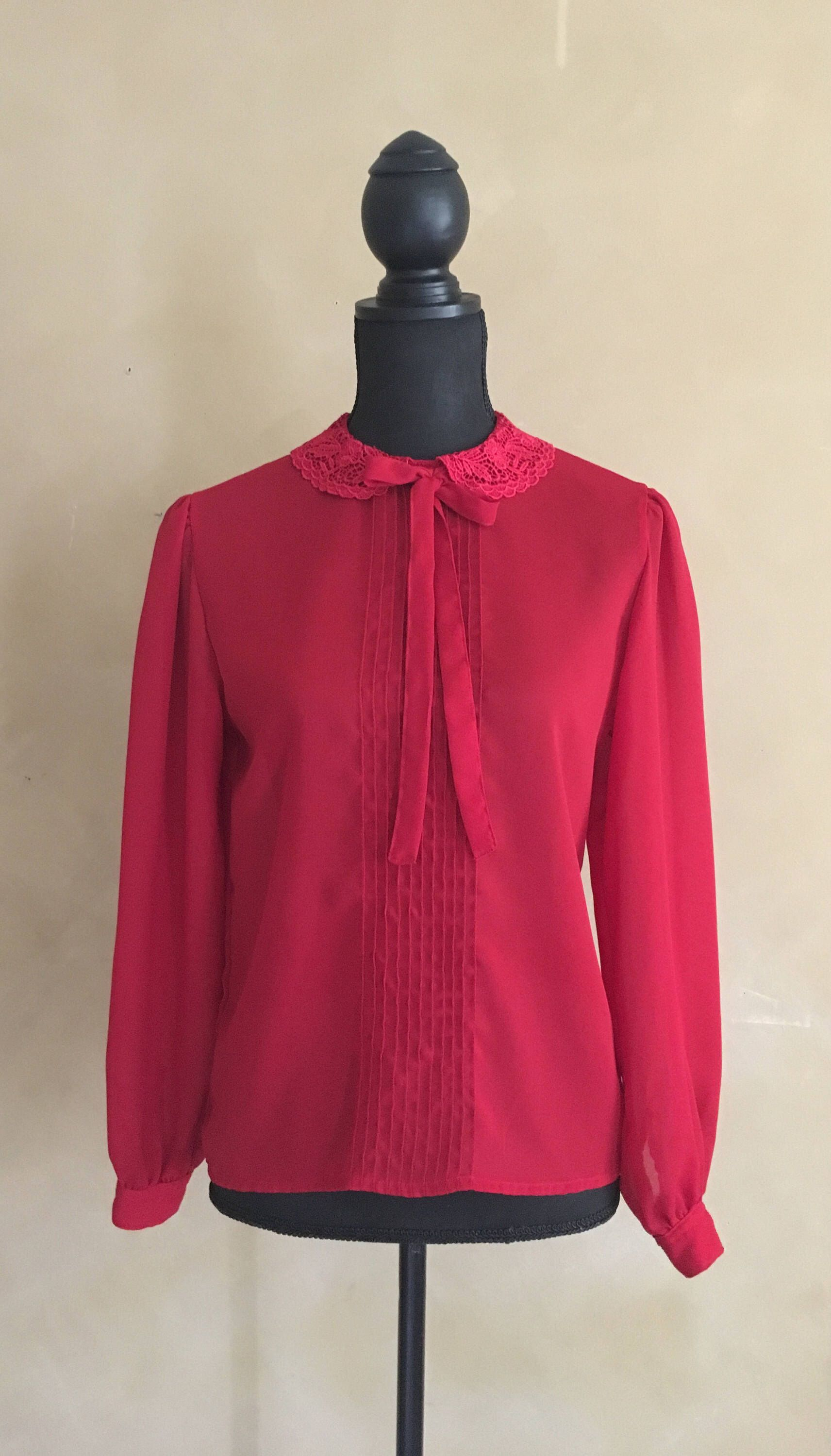 A personal favorite from my Etsy shop https://www.etsy.com/listing/529461121/vintage-70s-red-blouse-high-lace-collar