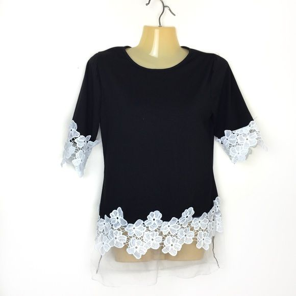 Boutique XS black and white blouse Excellent condition. Smoke and pet free home. Black 3/4 sleeve blouse with white crochet flower trim on sleeves and bottom. Bottom also has a sheer trim. No tag inside, fits a XS/S. No trades, bundle for discounts Tops Blouses