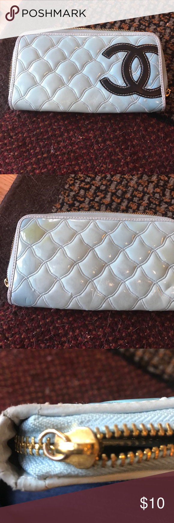 Large wallet Off brand. Needs new pull zipper but easy to fix. Has small yellow mark on back Bags Wallets