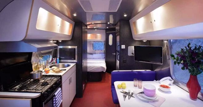 Rare Airstream Takes Cool To The Next Level With The 70s Vibe Of Its Kitchen Airstream Airstream Caravans Glamping
