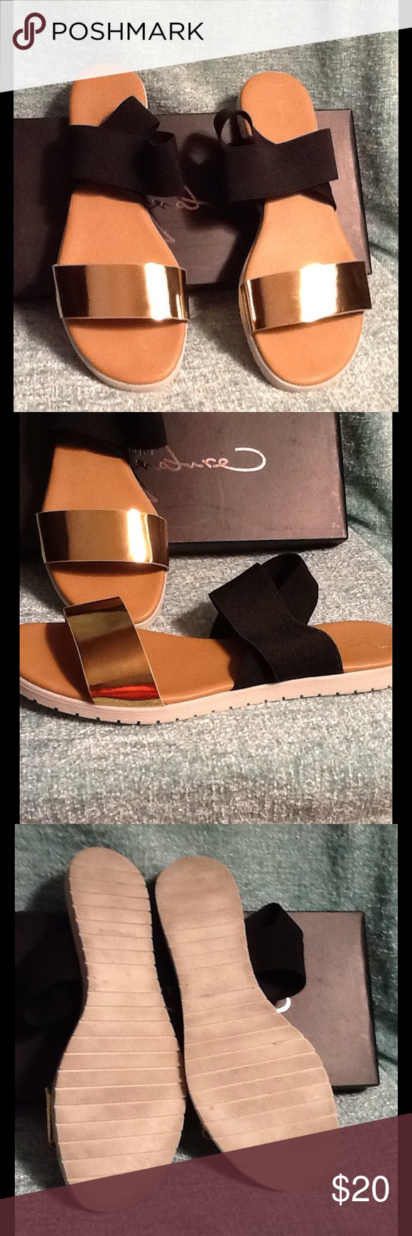 Black and Bronze Flat Sandals In original box. These are new but were worn in a department store fashion show. Manmade with cushioned footbed. Made by Report Signature and have the style name of Peyson. Elastic straps around the ankle. Report Signature Shoes Sandals